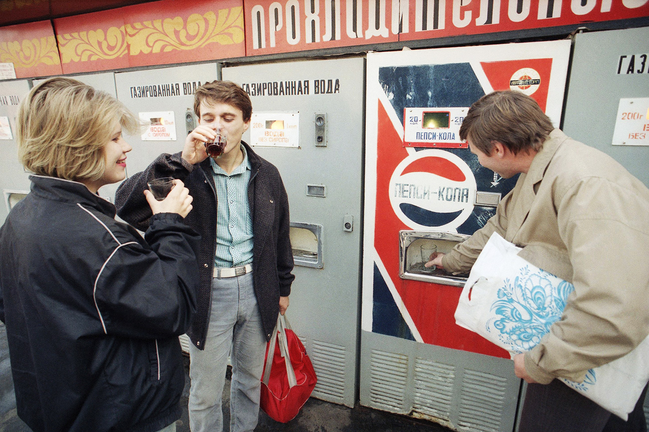 Thirsty Muscovites gather at a Pepsi Cola machine in Moscow, Friday, Sept. 6, 1991. The soda sells for 20 kopeks, about 10 cents a serving.