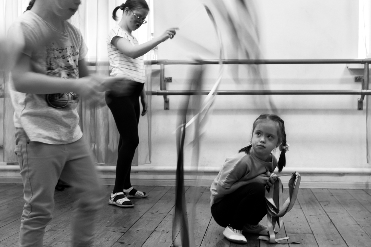 In the studio, kids do physical exercises and learn how to balance on a ballet barre and develop their coordination and motor functions.