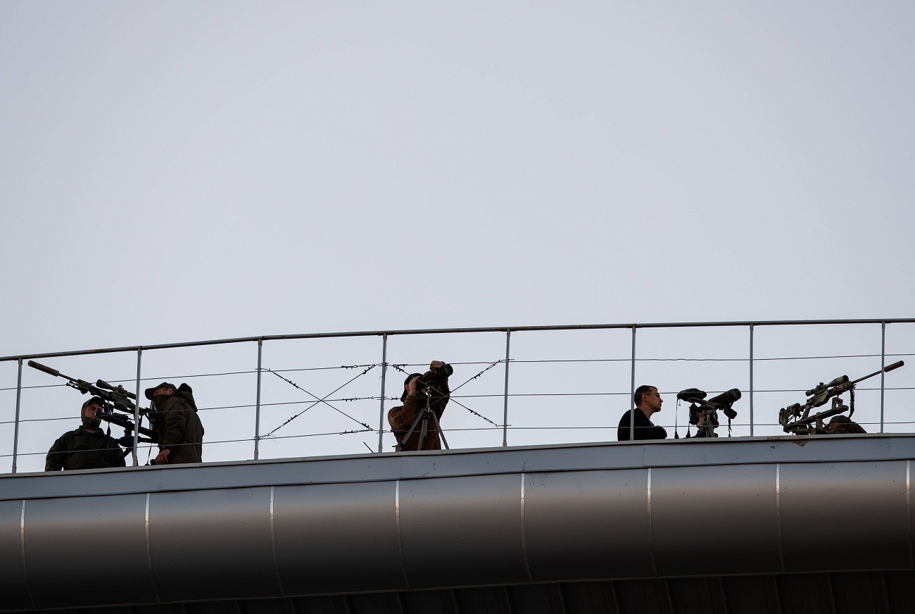 Russian police on the roof structure of the Krestovsky stadium in Saint-Petersburg.