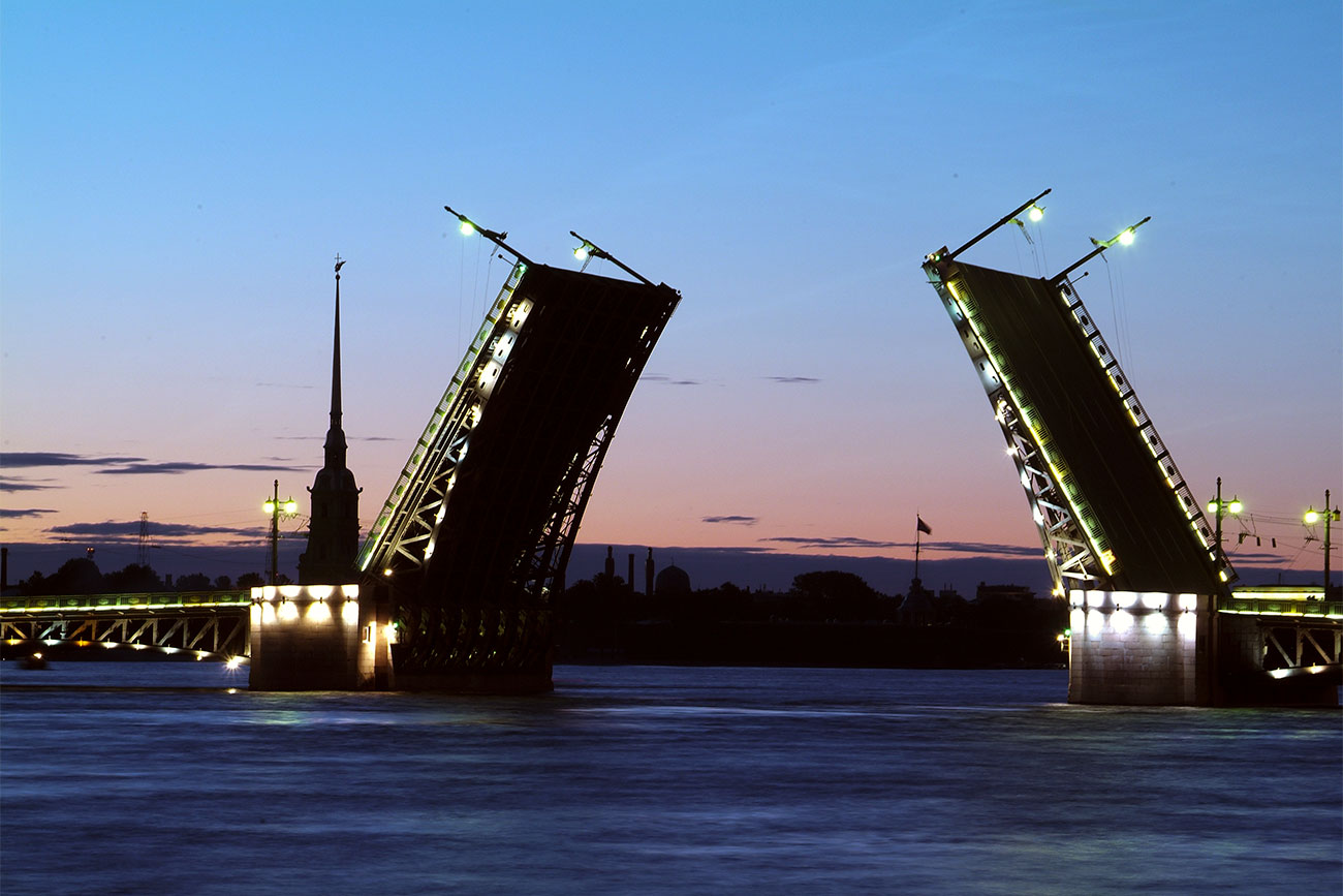 Palace drawbridge risen. The Neva River, night time. St. Petersburg, Russia.