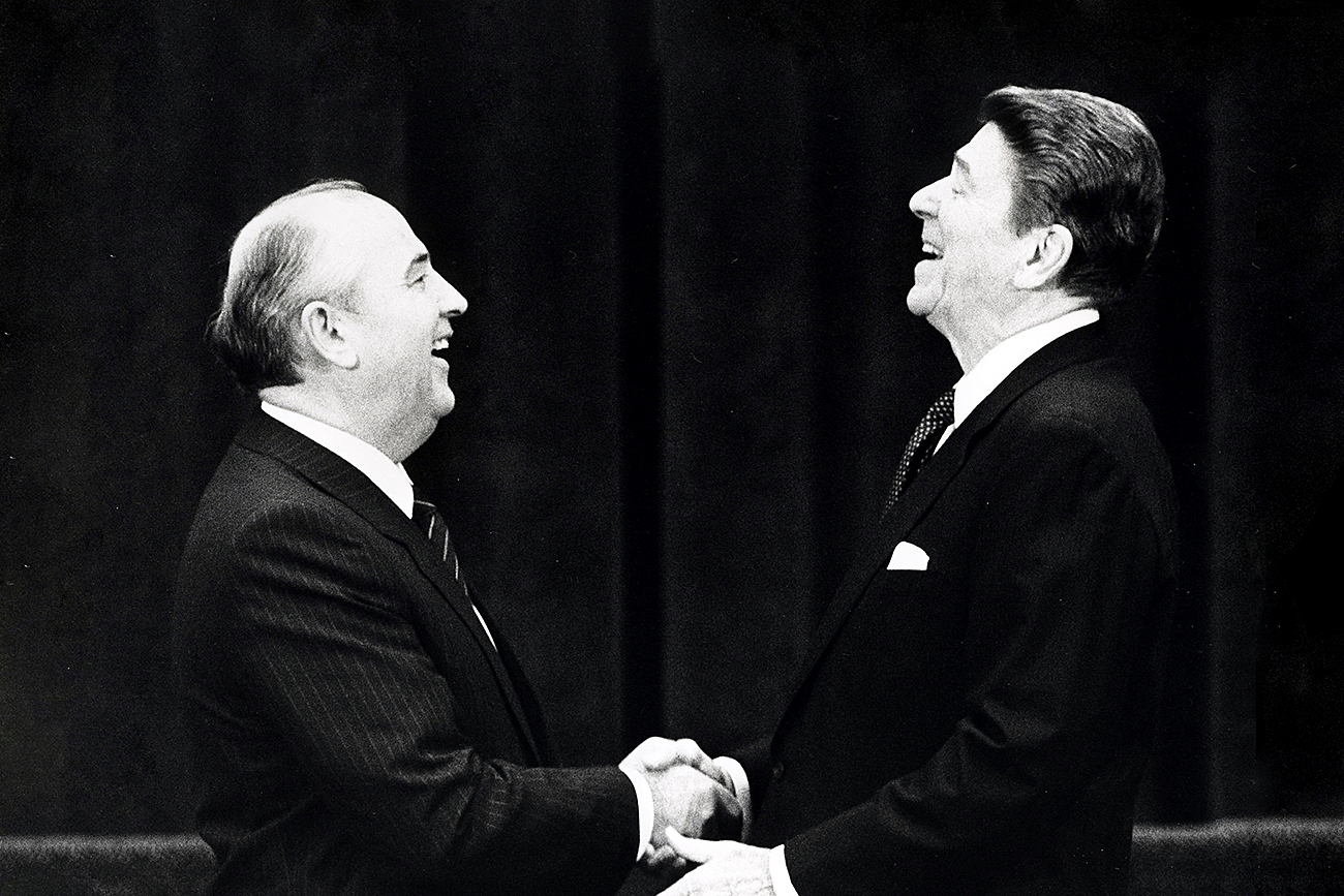 U.S. President Ronald Reagan (R) shakes hands at his first meeting with Soviet leader Mikhail Gorbachev to sign an arms treaty in Geneva, in this November 19, 1985 file photo. The two leaders met for the first time to hold talks on international diplomatic relations and the arms race.