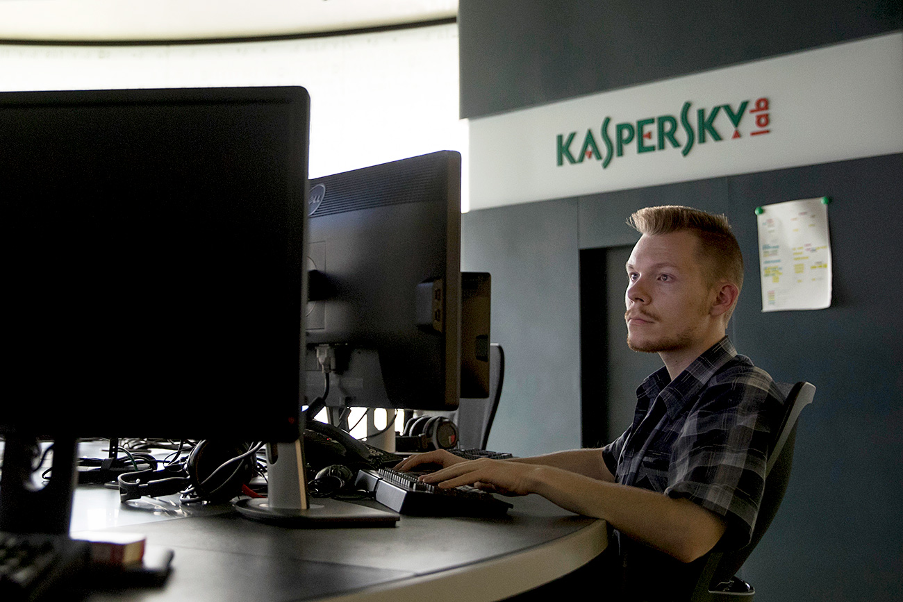 An employee of Kaspersky Lab works on computers at the company's headquarters in Moscow, Russia