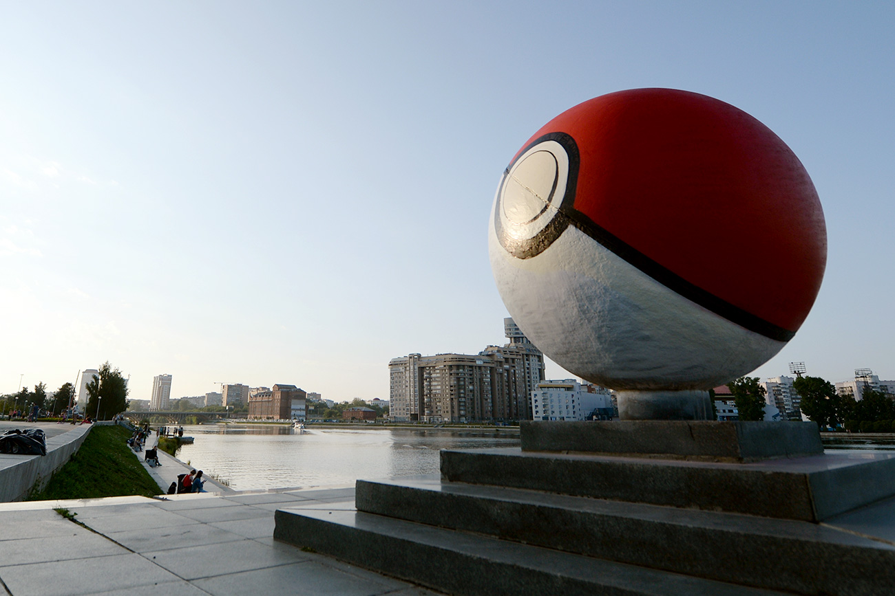 Roma Ink, a street artist from the Russian city who hides his identity, was responsible for creating the giant Poké Ball. Source: Pavel Lisitsyn/RIA Novosti