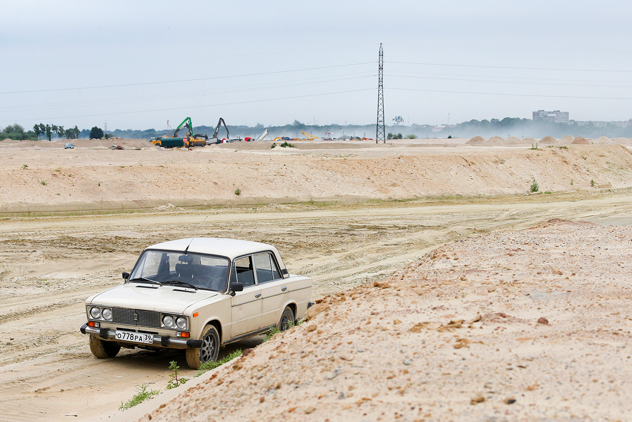 Lada car is parked at the construction site of Kaliningrad stadium in the Baltic Sea port of Kaliningrad, Russia, July 18, 2015. Kaliningrad is one of the Russian cities, which will host the 2018 World Cup.