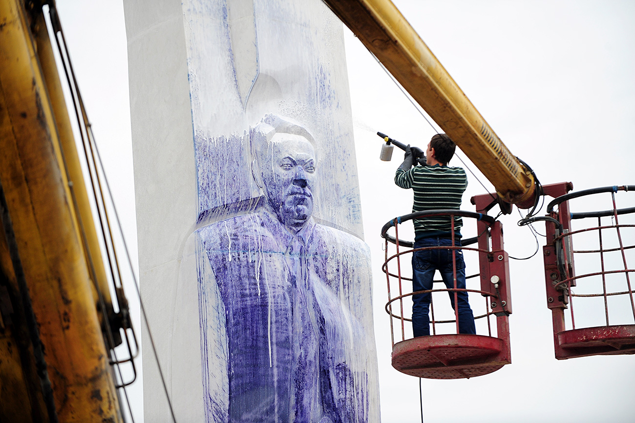 Cleaning the memorial to first Russian president Boris Yeltsin in Yekaterinburg partially destroyed and sprayed with paint.