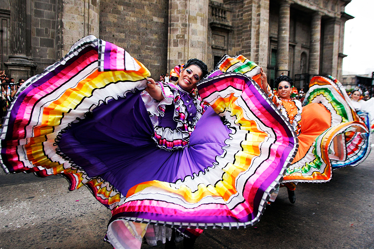 Folkloric dancers perform during the annual Charros and Mariachi parade in Guadalajara. Charros are cowboys and cowgirls, and Mariachis are traditional Mexican musicians who play songs for paying customers in public places, bars and restaurants and are renowned for their elaborate outfits and sombreros
