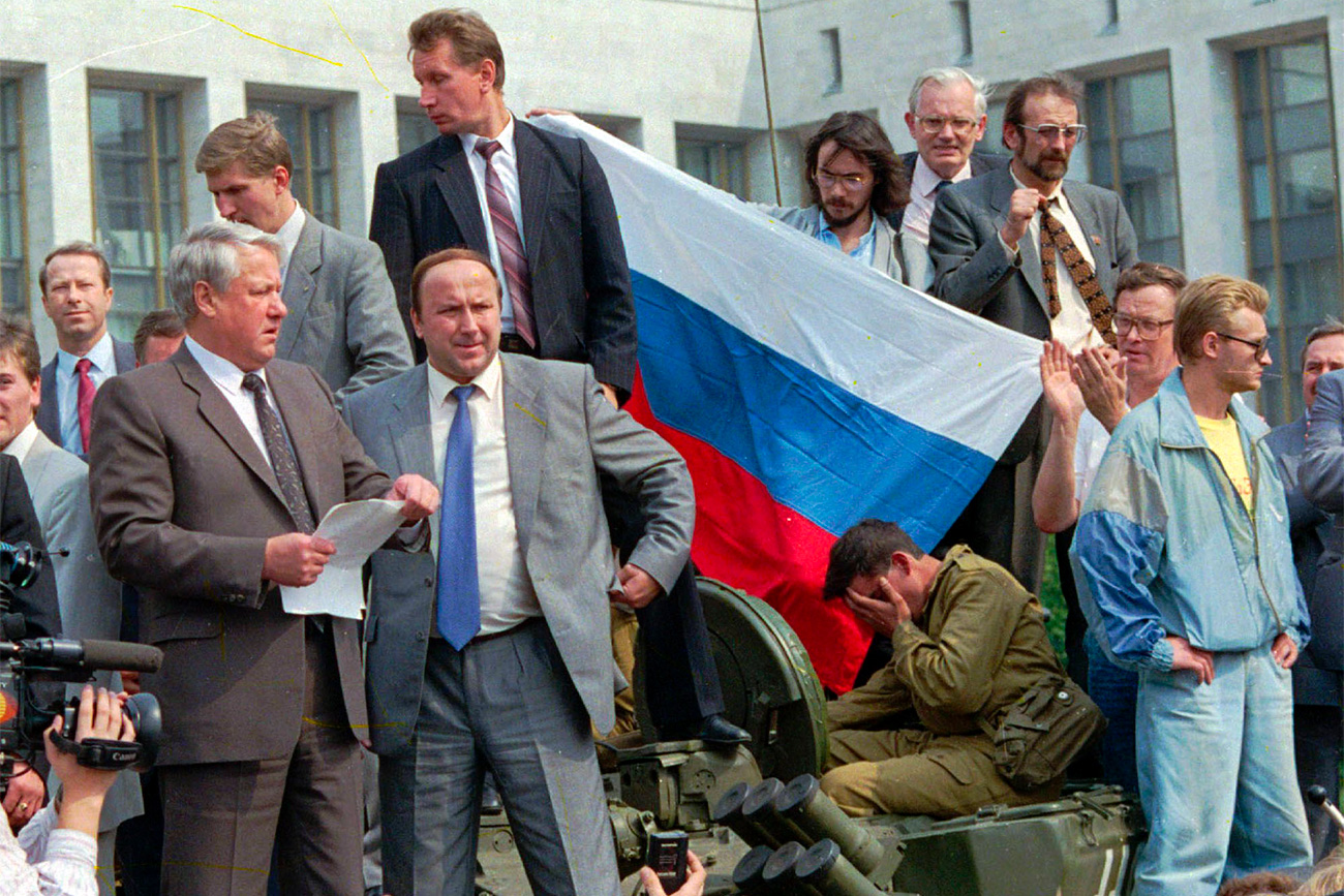 Russian President Boris Yeltsin reads a statement from atop a tank in Moscow, Soviet Union, photo as he urged the Russian people to resist a hardline takeover of the central government, Aug. 19, 1991.