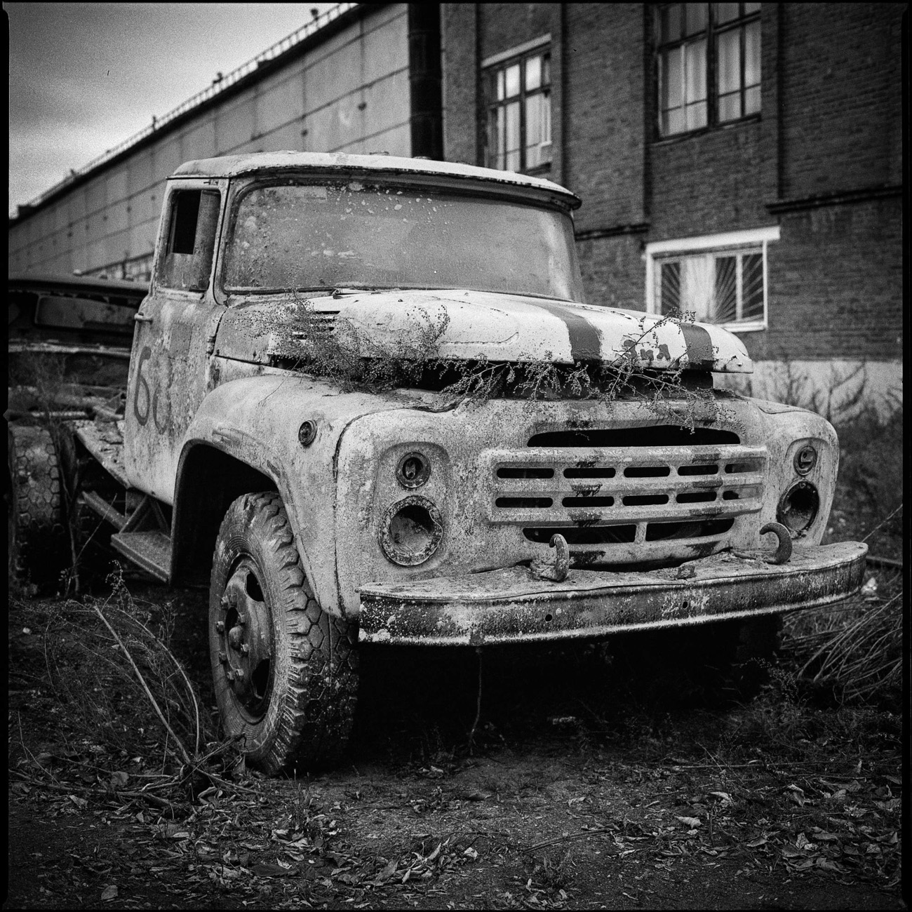 An abandoned ZIL 130 awaits its turn for the scrap heap. Back in 1963, it was one of the most modern trucks of its time. It was even given the USSR mark of quality.