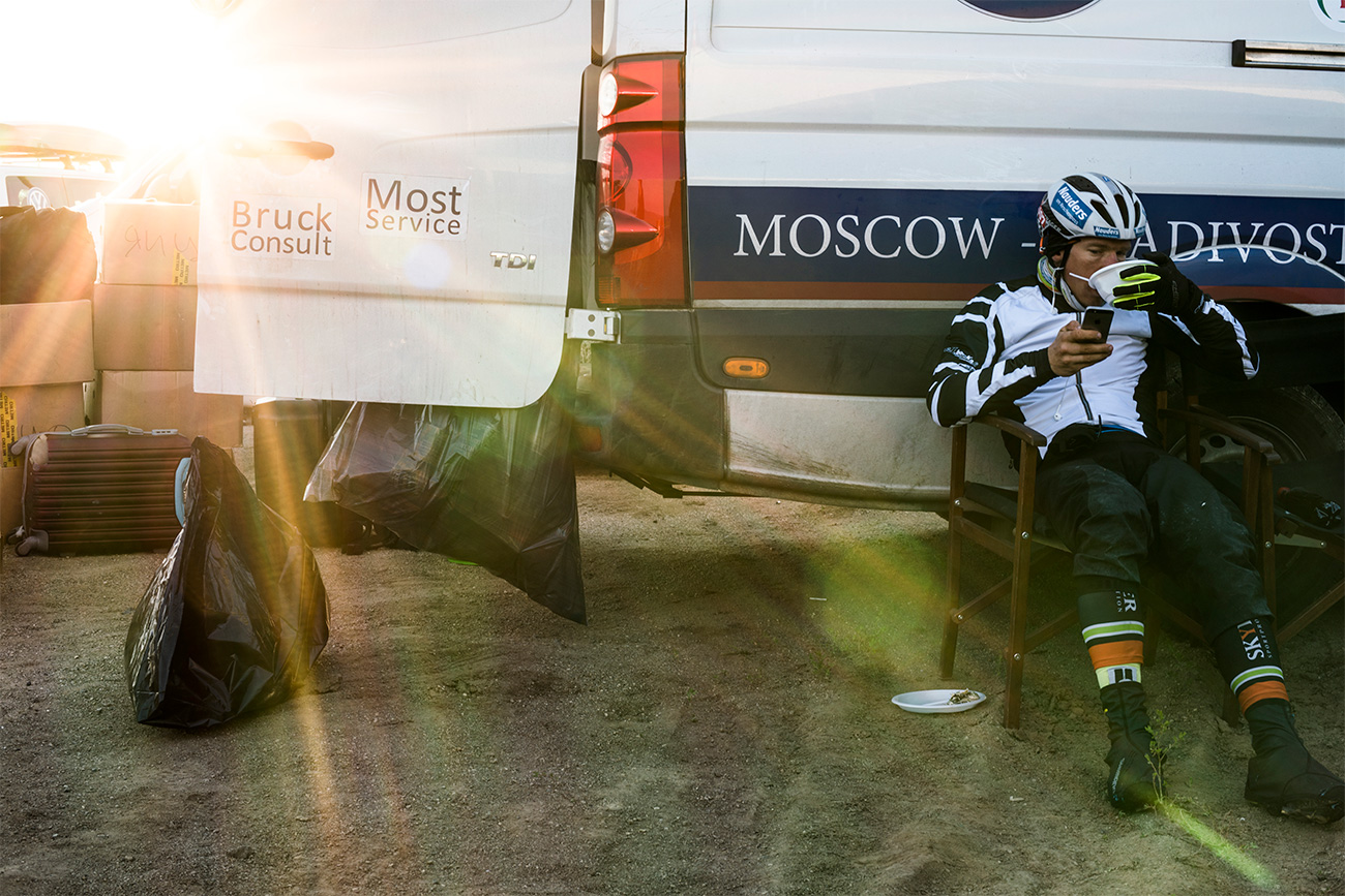 A back-up car was the cyclists' permanent satellite, carrying water, food, medical care and even extra bikes. Pierre Bischoff from Germany is seen during the 11th Ulan-Ude-Chita stage.