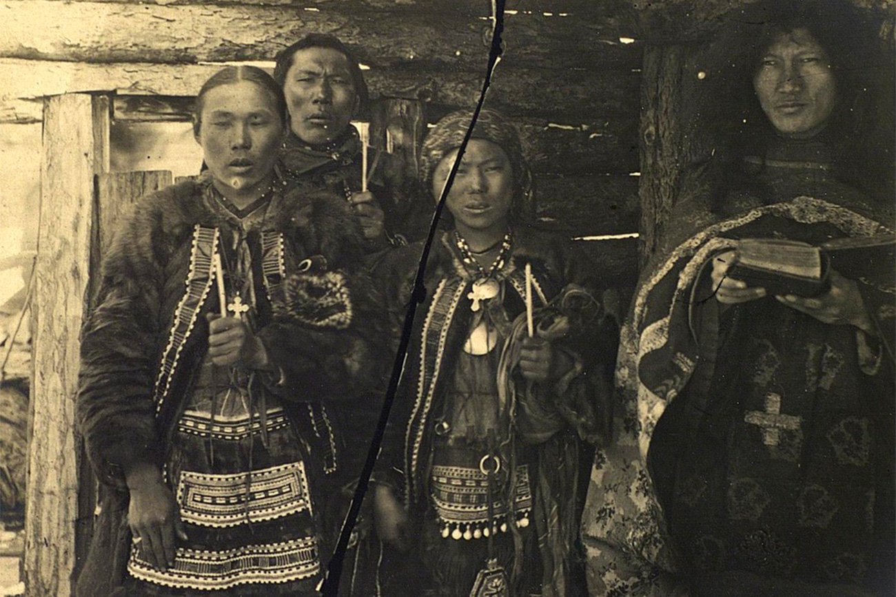 The wedding`s size, number of guests, food, and gifts depended on the family's wealth. There were almost always horses, koumiss (low-alcoholic drink made of mare`s milk), and meat, lots of meat. (Wedding ceremony: Groom, bride, and shaman (right), 1885-1899)