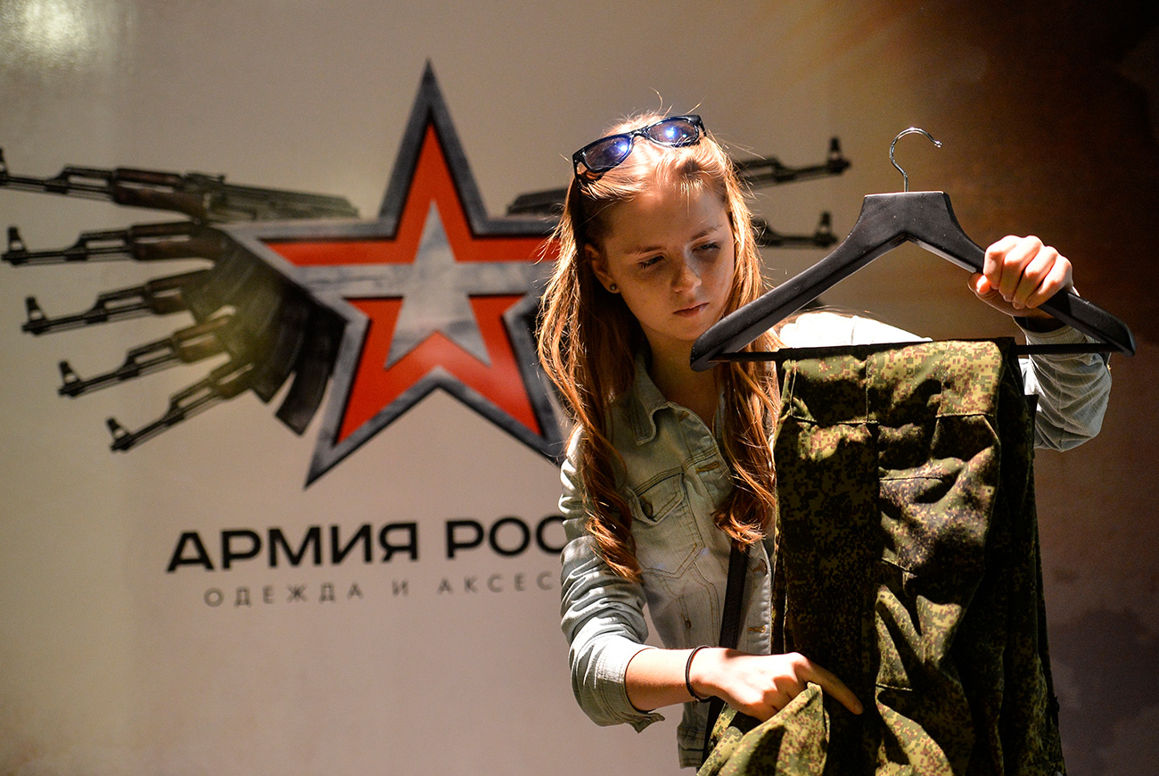 Customer examines goods at the Russian Army store on Tverskaya Street in Moscow.