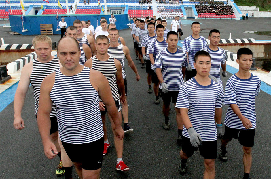 Russian and Chinese sailors at the start of the boat race in joint naval exercises in Vladivostok.