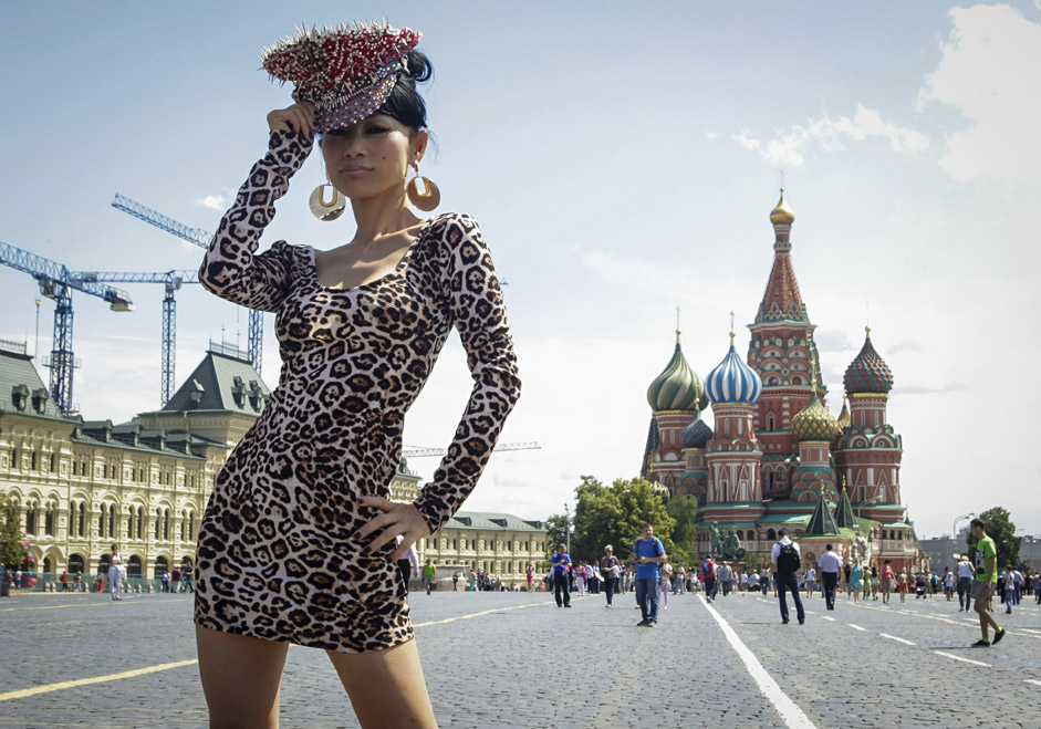 Actress Bai Ling poses for a picture in front of St. Basil's Cathedral at the Red Square in Moscow, Russia, July 1, 2015.