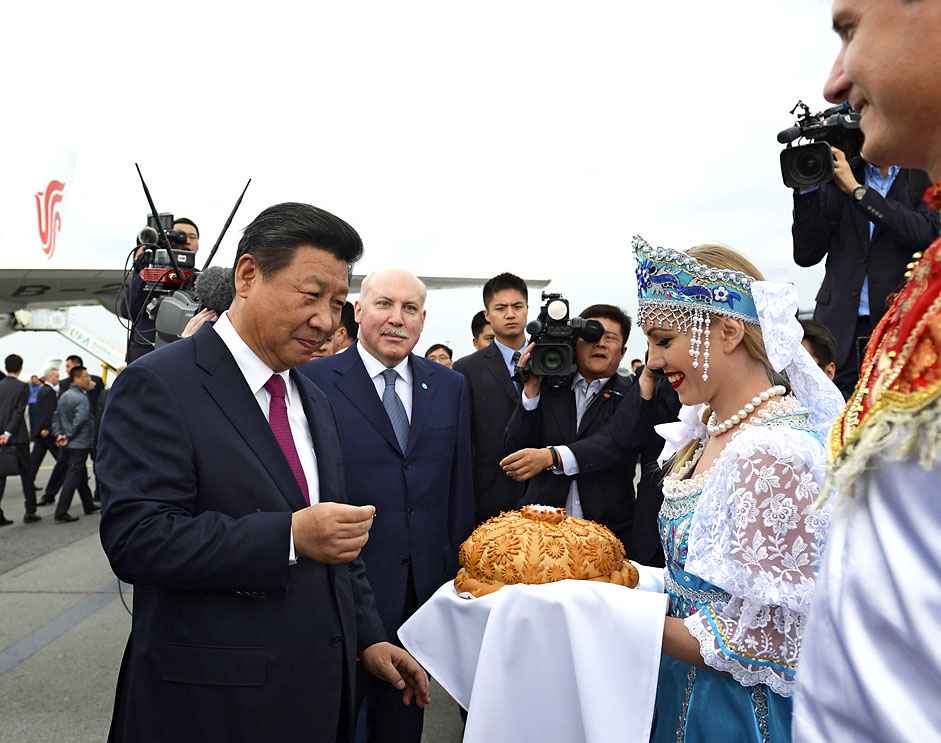 Chinese president Xi Jinping takes part in a traditional bread and salt ceremony upon his arrival before attending the Shanghai Cooperation Organization (SCO) and the BRICS summits in Ufa, Russia on July 8, 2015. Source: Reuters