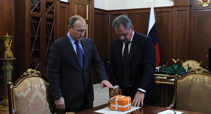 Vladimir Putin during the meeting with Defense Minister Sergei Shoigu, Dec. 8.