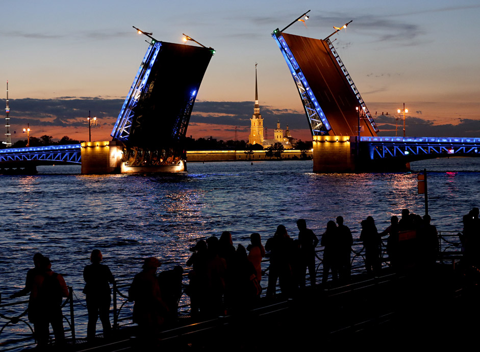 Tourists enjoy a view of the historical center of St. Petersburg, Russia, during the so-called 'White Night'