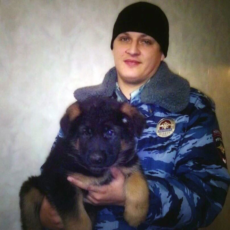 A handout picture released by Russian Interior Affairs Ministry shows a unnamed Russian policeman holding a German shepherd puppy named Dobrynya which Russia is sending to France in the cuddliest show of international solidarity possible to replace the French police dog Diesel, who was killed during an anti-terrorism raid on an apartment Wednesday, Moscow, Russia, 22 November 2015.