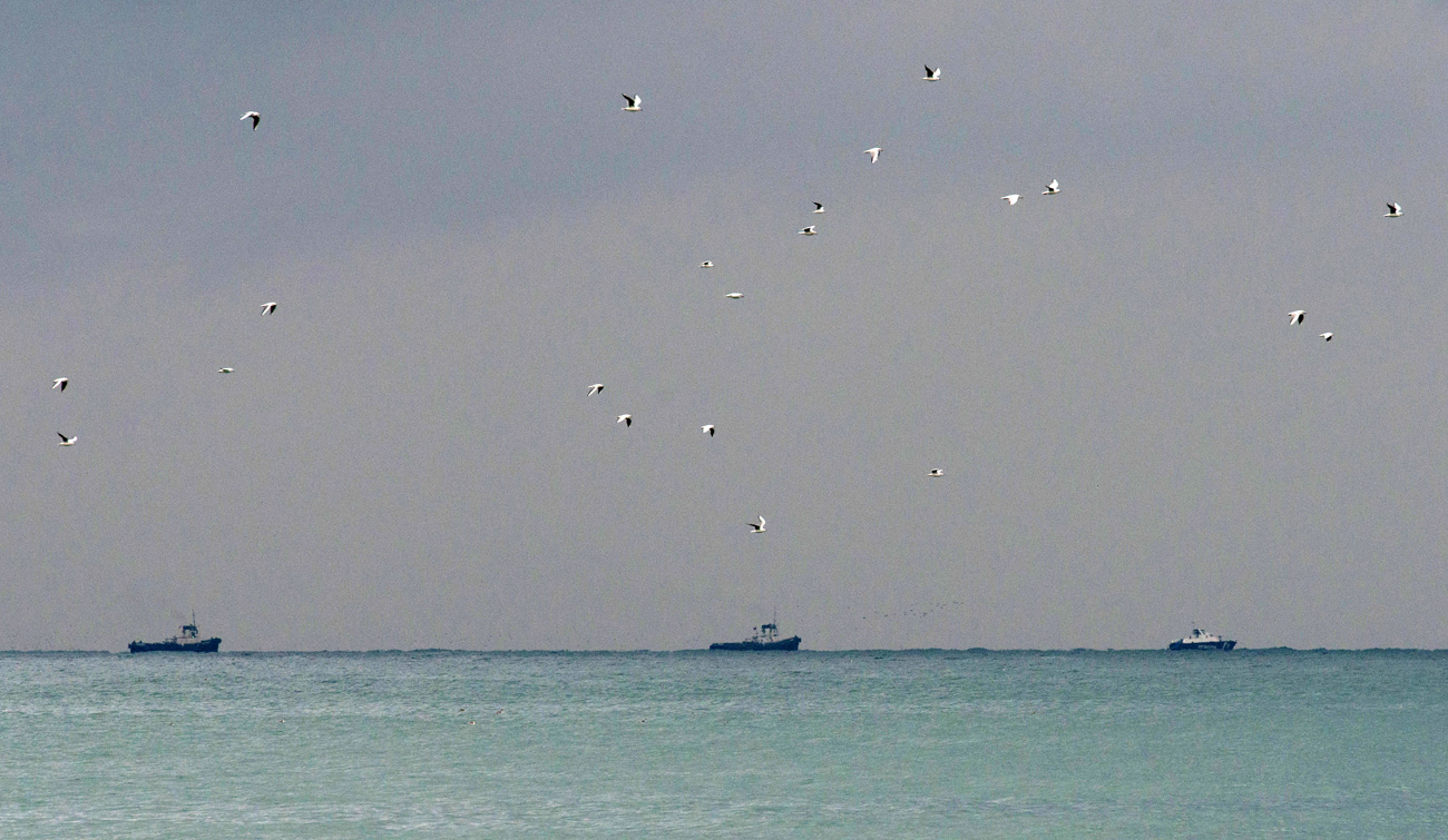 Rescue boats search for the wreckage of a crashed Russian Tu-154 plane, belonging to the Russian Defense Ministry near the coastline of Sochi.