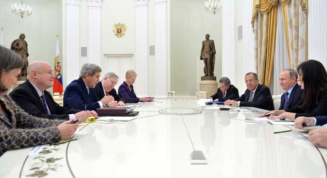 U.S. Secretary of State John Kerry during the meeting with Russian President Vladimir Putin and Russian Foreign Minister Sergei Lavrov.