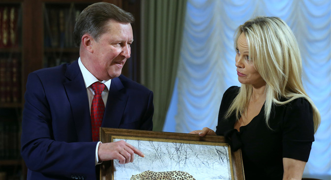 Pamela Anderson and Kremlin's Chief of Staff Sergei Ivanov during a meeting at Moscow's Kremlin, Dec. 7, 2015.