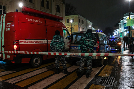 Police officers at the site of a blast at a bus stop in Pokrovka Street, Dec. 8, 2015.