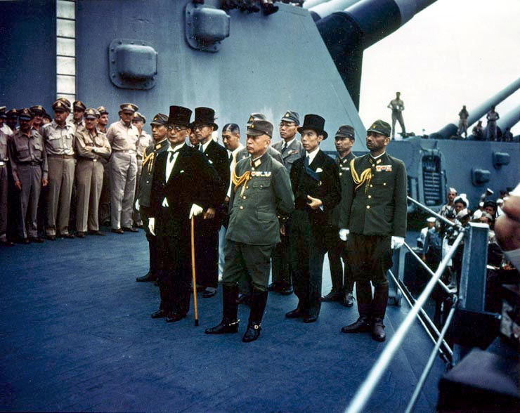 Representatives of Japan stand aboard USS Missouri prior to signing of the Instrument of Surrender.