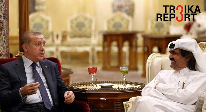 Turkey's President Recep Tayyip Erdogan, left, speaks to Qatar's Emir Tamim bin Hamad Al Thani in Doha, Qatar, Dec. 1, 2015.