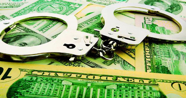 Keine Dollar, dafür Handschellen - der Kampf gegen die Korruption geht in eine neue Runde. Foto: PhotoXPress