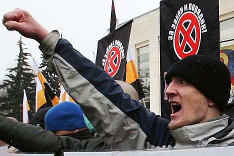 O banner diz: para a lei e a ordem! / Foto: AFP_EastNews