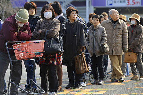 People queue for supplies outside a shop in Fukushima on March 13, 2011 following the massive earthquake and tsunami. Source: PHILIPPE LOPEZ/AFP/Getty Images