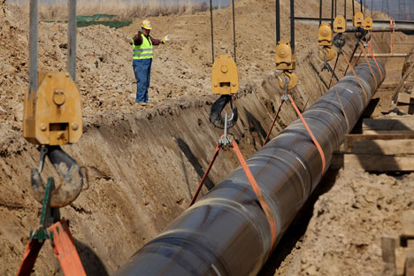Pipe dream: workers at Germany's port of Lubmin lower a section of pipeline into place as part of the Nord Stream gas link being built from Russia. Source: Getty Images/Fotobank