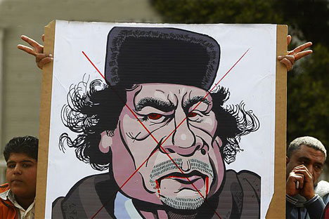 Protesters display a caricature of Libyan leader Muammar Gaddafi outside the Arab League headquarters in Cairo during an emergency meeting of the League's foreign ministers to discuss Libya. Source: REUTERS/Vostock Photo/Amr Abdallah Dalsh