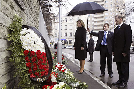 Russia's First Lady Svetlana Medvedeva takes part in a flower-laying ceremony, with Polish Ambassador to Russia Wojciech Zajączkowski, outside the Polish embassy to mark the first anniversary of the plane crash. Source: Reuters / Vostock Photo