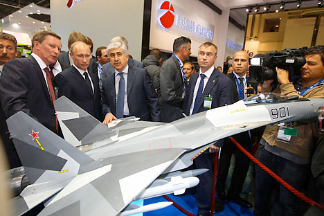 Russian Prime Minister Vladimir Putin (2ndL) visits the space dedicated to Russia at the Paris International Air Show on June 21, 2011 at the Le Bourget airport near Paris. Source: Reuters