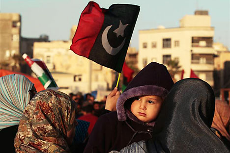 A protester holds her baby during an anti-Gaddafi demonstration in Benghazi. Source: Reuters/Vostock photo