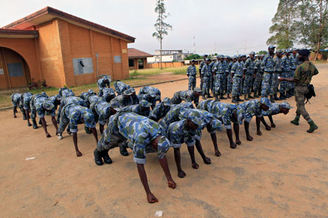 Soldiers from the 'Invisible Commandos,' loyal to Ibrahim Coulibaly, are punished by having to hold themselves up on their fists, during training in the PK-18 area of the Abobo neighborhood, in Abidjan, Ivory Coast Tuesday, April 19, 2011. AP Photo/R