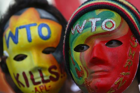 Filipino activists wear colourful masks during a rally against the economic liberalization policies pushed by the World Trade Organization. Source: AP/Mike Alquinto