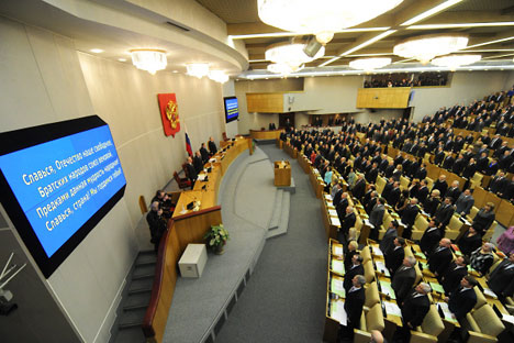 Russian MPs singing the national anthem before the first session of the State Duma. Source: RIA-Novosti