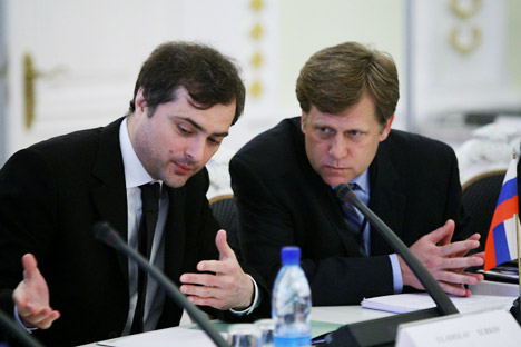 Former Head of the Presidential Administration Vladislav Surkov and new U.S. Ambassador in Moscow Michael McFaul (L-R at the table) during one of the sessions of the Civil Society group. Source: RIA Novosti