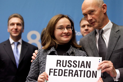 WTO Director general Pascal Lamy (R) holds a sign with Elvira Nabiullina, Minister of Economic Development (C) next to Igor Shuvalov, Russia Deputy Prime Minster of Russia after the signature of the accession of the Russian Fedration as WTO member in
