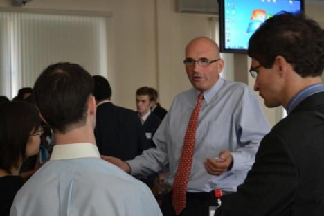 Bernard Sucher, the member of the Board of Directors at Aton Group, is talking with students as a guest speaker at the 2011 Stanford U.S.-Russia Forum in Moscow. Source: Pavel Koshkin