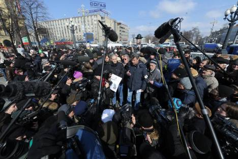 Speaking out: opposition leaders Sergei Udaltsov and Boris Nemtsov address a rally for fair elections in Pushkin Square. Source: Photoshot / Vostock Photo