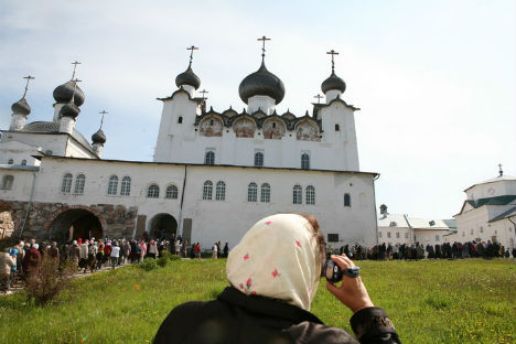 The Solovetsy Islands in the White Sea. Pictured: A pilgrim videotaping the religious procession. Source: Grigory Kubatian