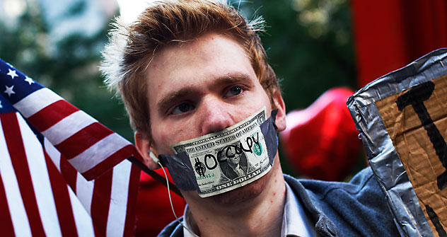 An Occupy Wall Street campaign demonstrator stands in Zuccotti Park, near Wall Street in New York October 17, 2011. Source: Reuters / Vostock Photo