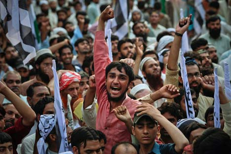 A supporter of the banned Islamic organization Jamaat-ud-Dawa shouts anti-American slogans during a rally in favour of al Qaeda leader Osama bin Laden in Lahore May 15, 2011. Source: Reuters/Vostock photo