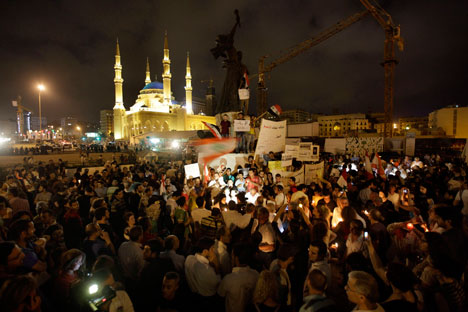Lebanese intellectuals and journalists protest during a vigil sit-in to show their support to the Syrian protesters who demonstrate against the Syrian President Bashar Assad, at the Martyrs square, in downtown of Beirut, Lebanon, on Monday Aug. 8, 20