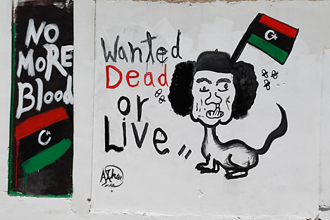 A caricature depicting Muammar Gaddafi is seen in Tripoli August 30, 2011. Source: Reuters / Vostock Photo