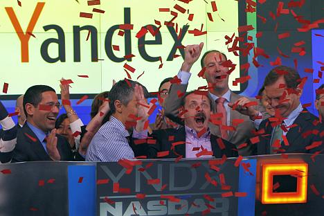 Arkady Volozh (3rd right), founder, CEO and largest stakeholder of the Russian search engine Yandex, celebrates the IPO in New York. Source: Reuters / Vostock Photo
