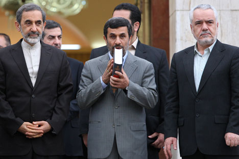 Iranian President Mahmoud Ahmadinejad kisses the Quran during a departure ceremony for him before leaving for Turkey to attend an international conference in May 2011.   Source AP