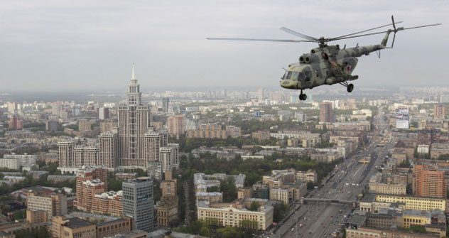 Mi-17 combat helicopter is flying over Moscow.   Source: RIA